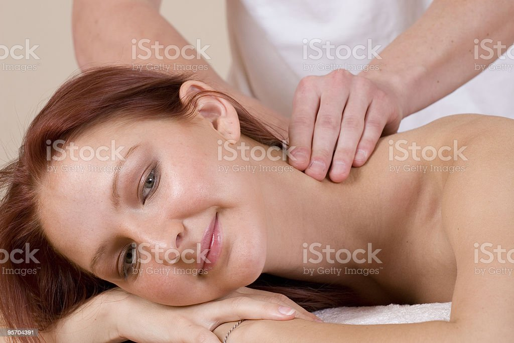 Young redheaded woman receiving a massage royalty-free stock photo