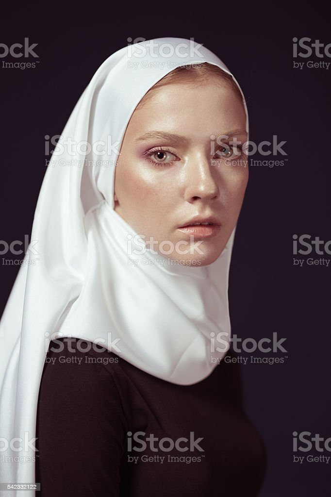 Young Religious Woman In A White Shawl stock photo