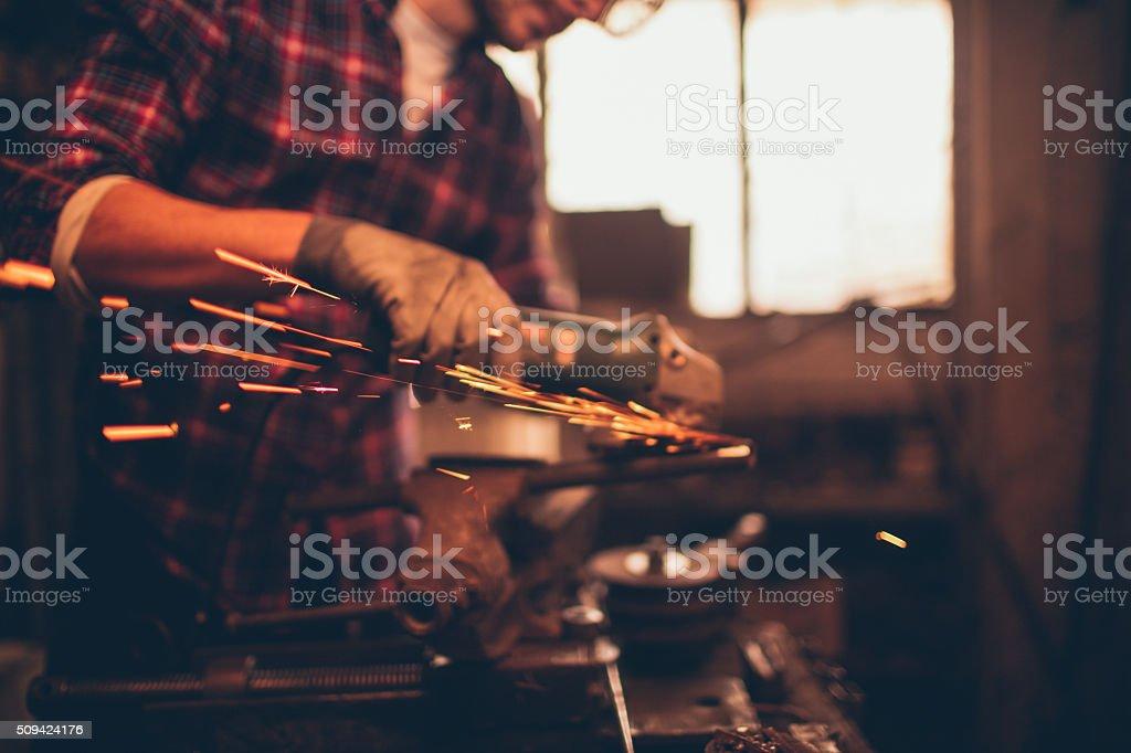 Young repairman in his workshop stock photo