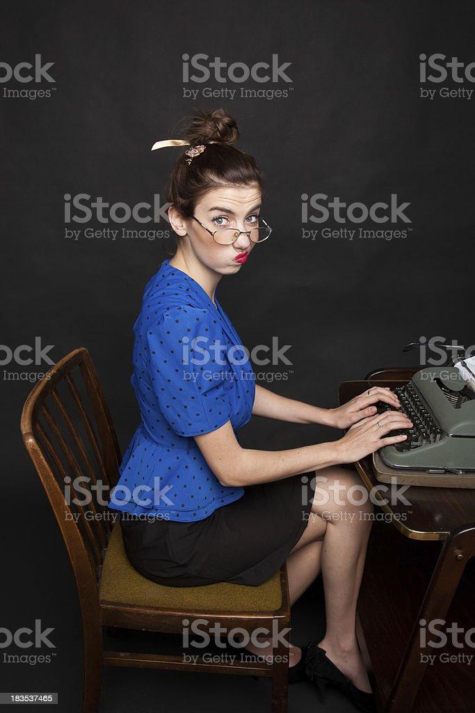 Young retro secretary typing royalty-free stock photo