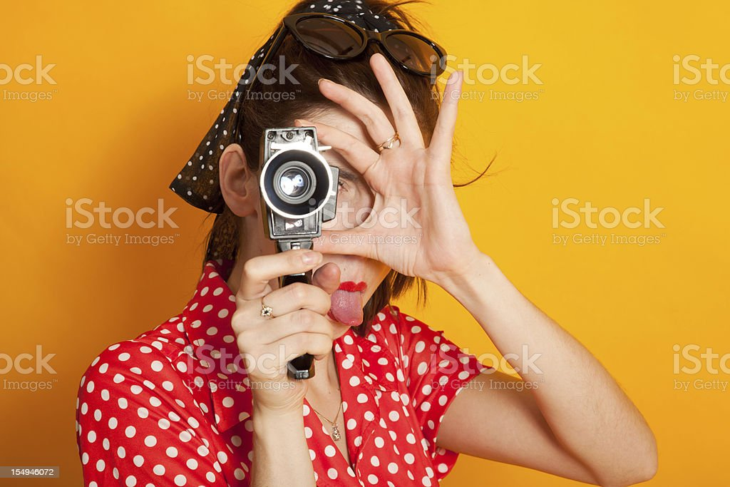 Young retro woman filming royalty-free stock photo