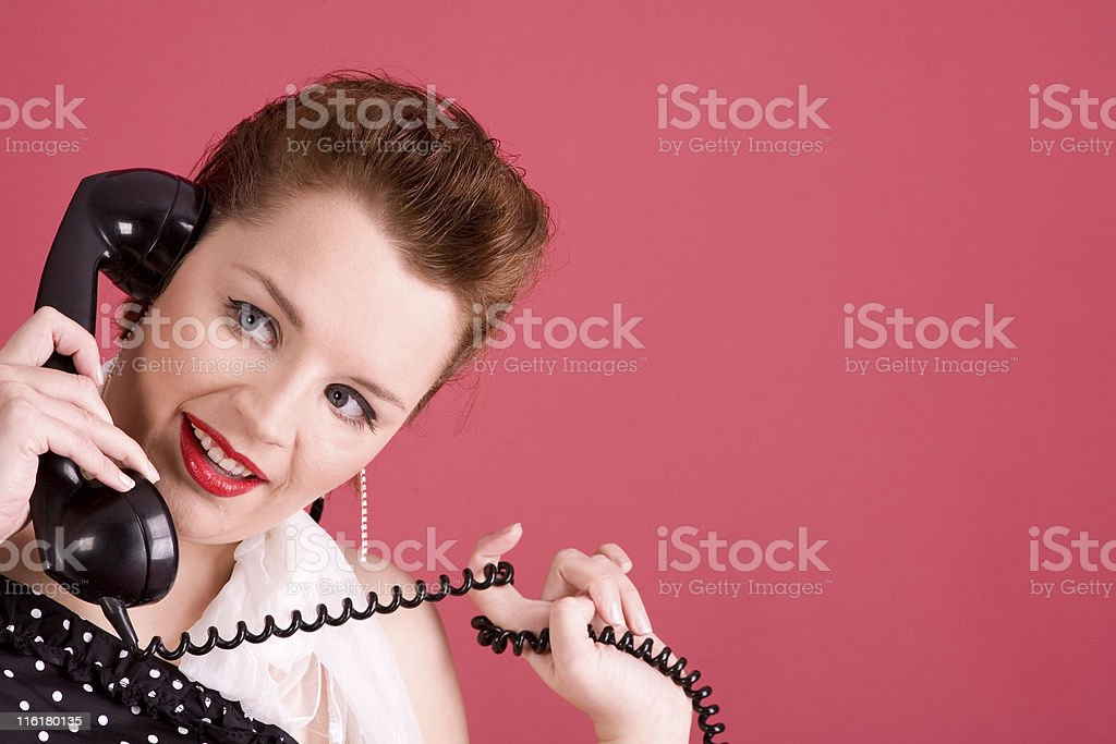 Young retro woman with vintage phone royalty-free stock photo