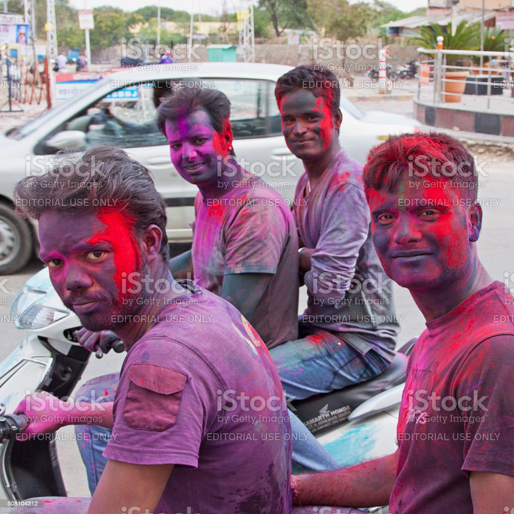 Young revellers celebrating the annual Hindu festival of Holi, India stock photo