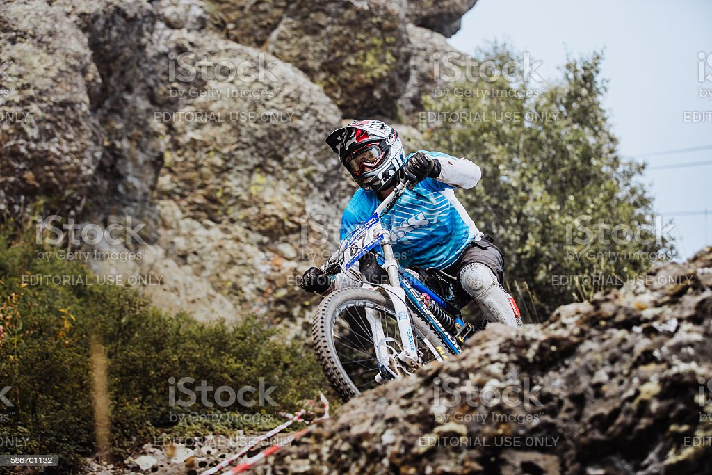 young rider athlete on bicycle on a rock royalty-free 스톡 사진