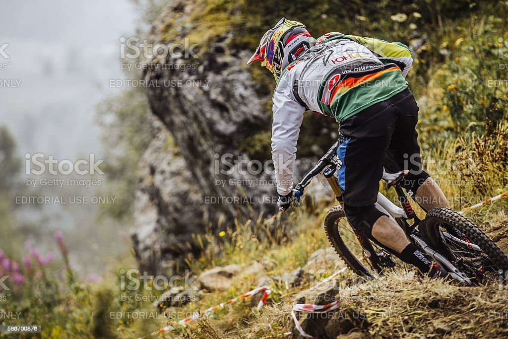young rider athlete on bike rides on a mountain trail royalty-free 스톡 사진