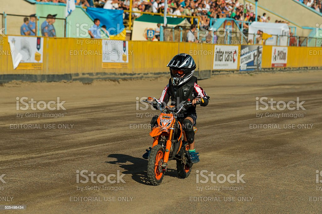 Young rider overcomes the track stock photo