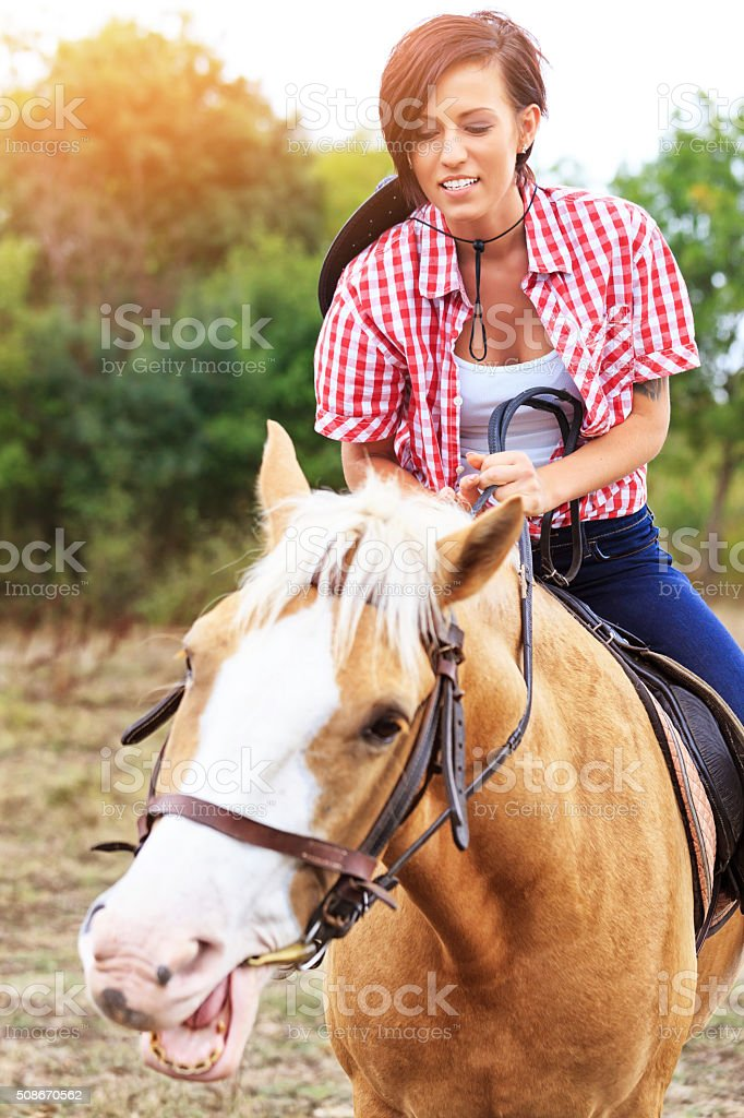 Young rider with her horse stock photo