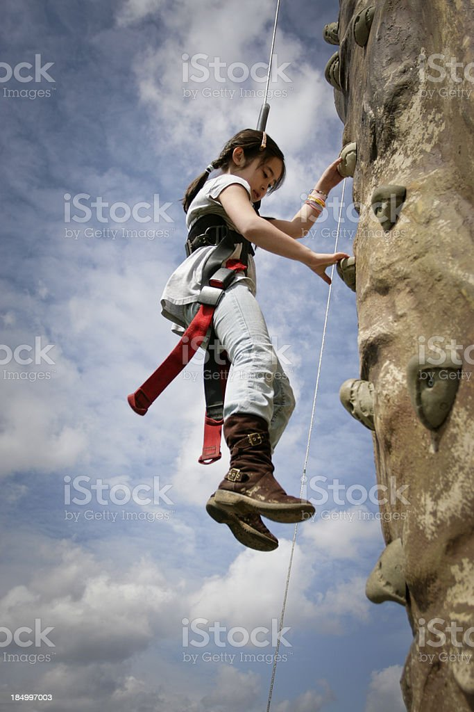 Young Rock Climber Descending stock photo