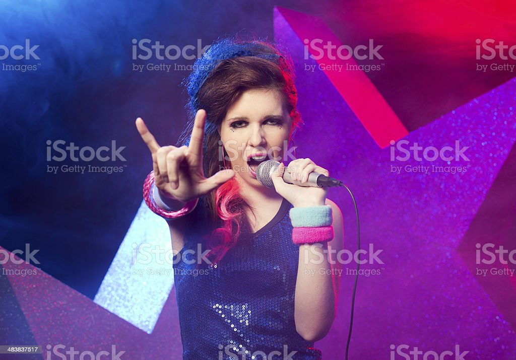 Young rock star performing stock photo