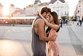Young romantic couple embracing in the city.