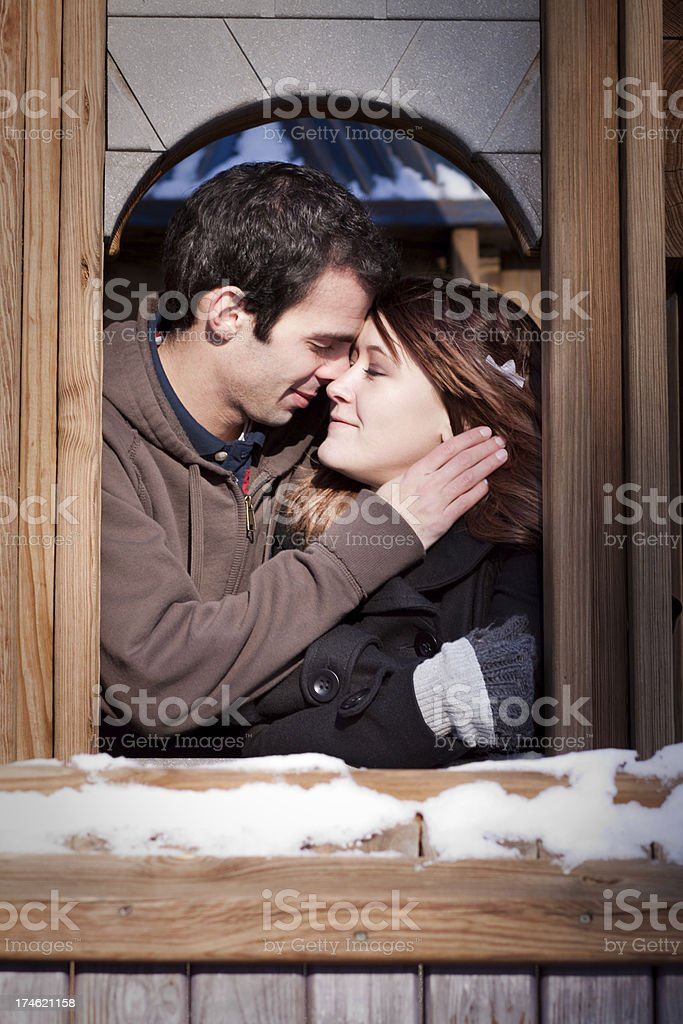 Young Romantic Couple Embracing Outdoors in Winter royalty-free stock photo