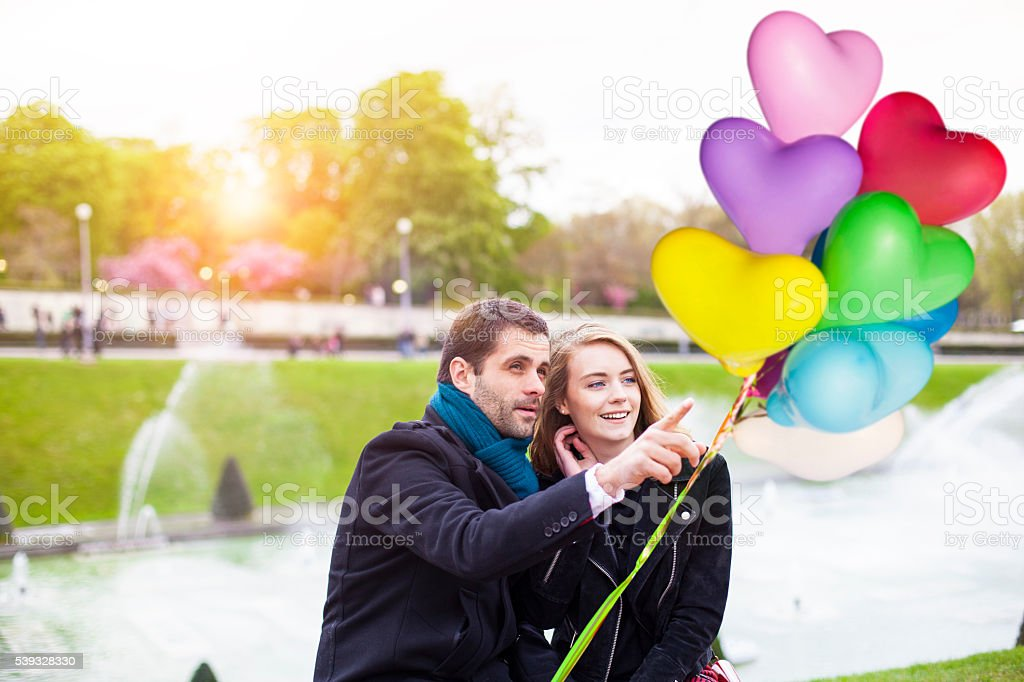 Young romantic couple having a date at Eiffel tower fountain stock photo