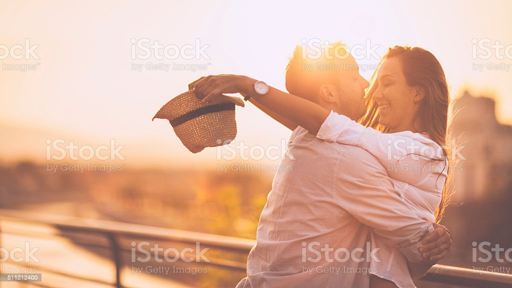 Young romantic couple having fun outdoors stock photo