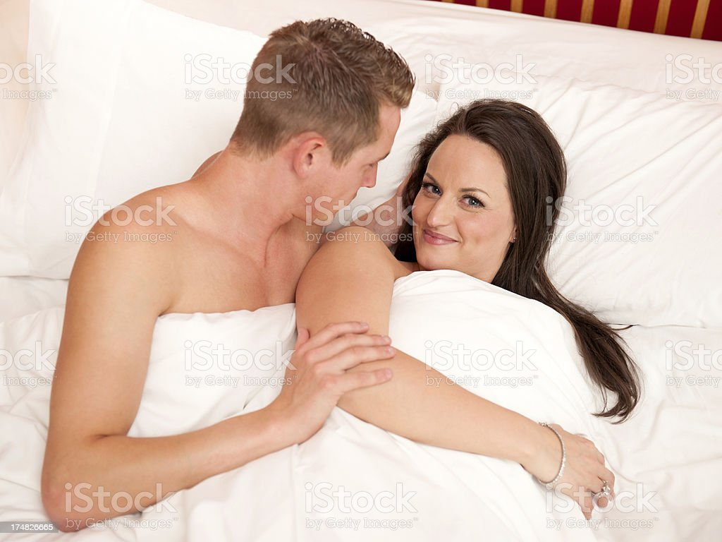 Young Romantic Couple in Bed royalty-free stock photo