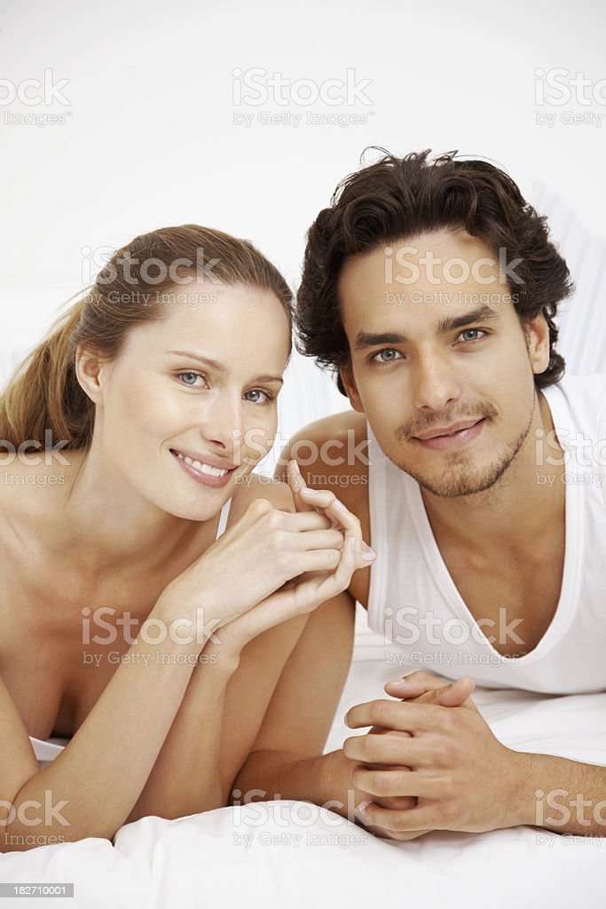 Young romantic couple lying together on the bed royalty-free stock photo