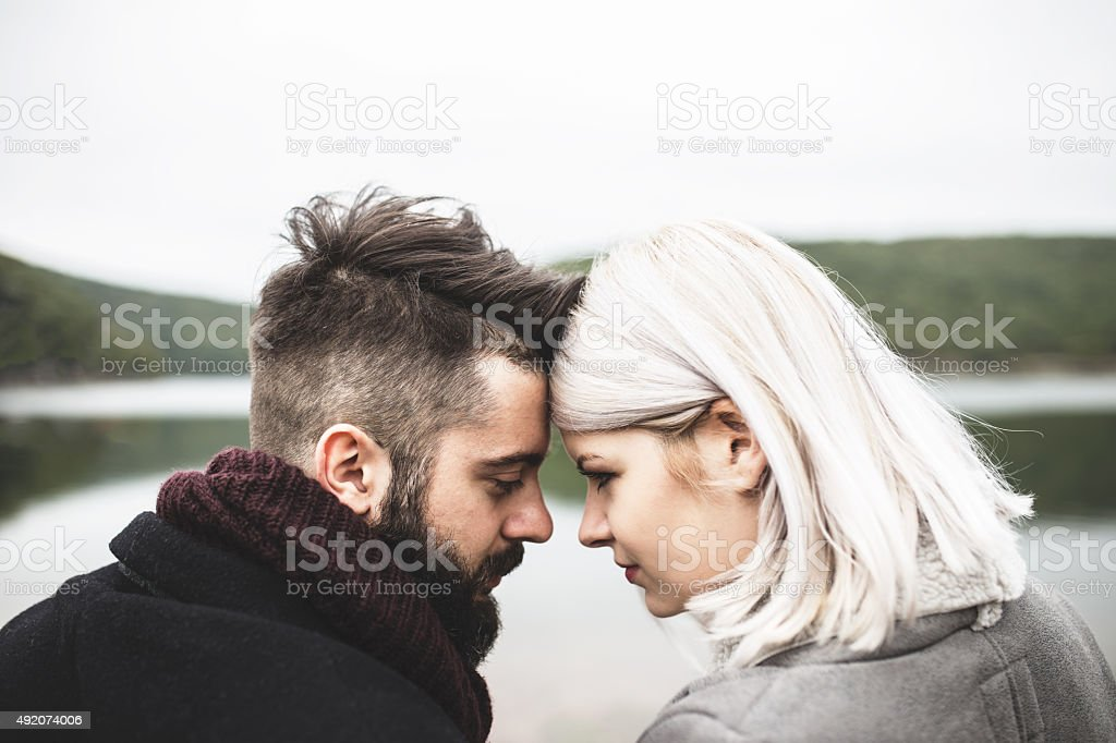Young romantic couple together outside stock photo