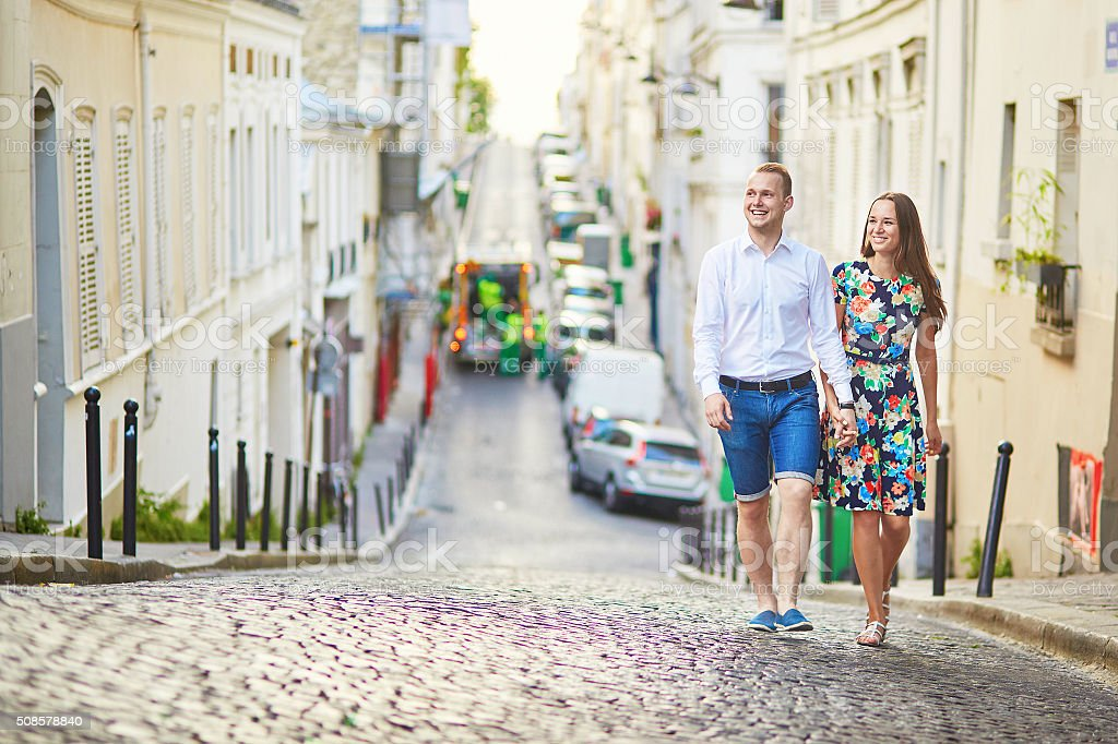 Young romantic couple walking on Montmartre stock photo
