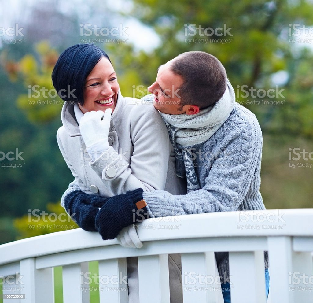 Young, romantic, happy couple embracing outdoors royalty-free stock photo