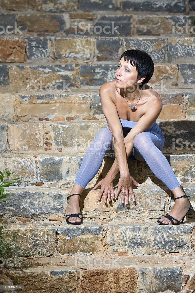 Young romantic sensual sexy beautiful tempting woman sitting on stock photo