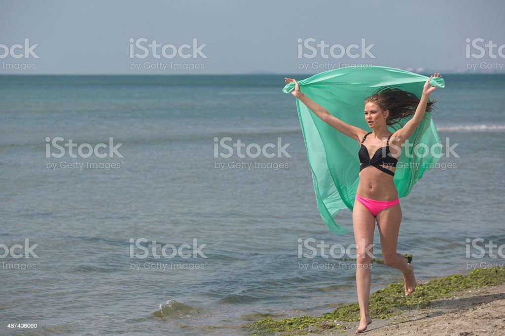 Young russian girl running at beach near istanbul turkey stock photo