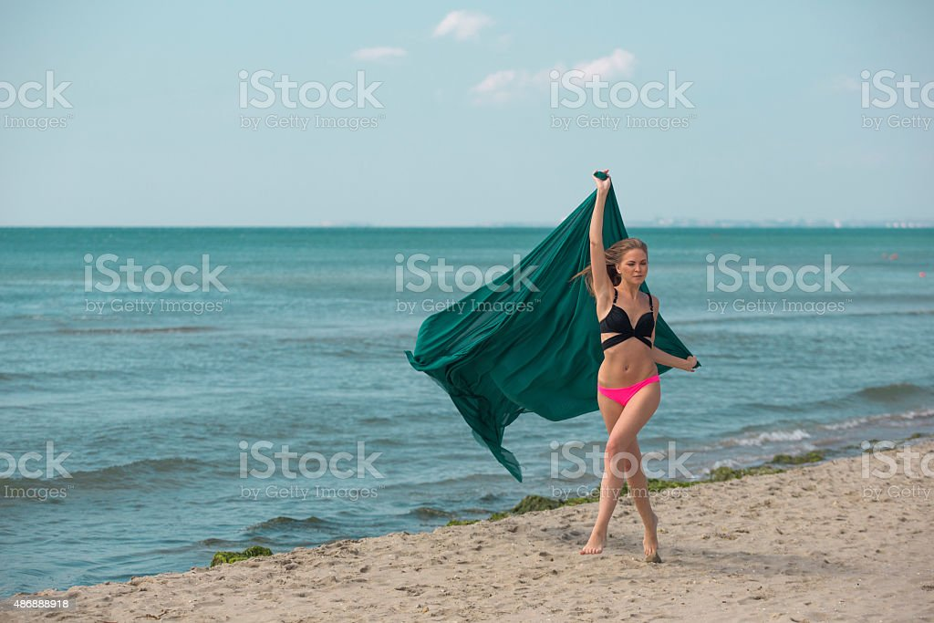 Young russian woman runing by seaside at istanbul turkey stock photo