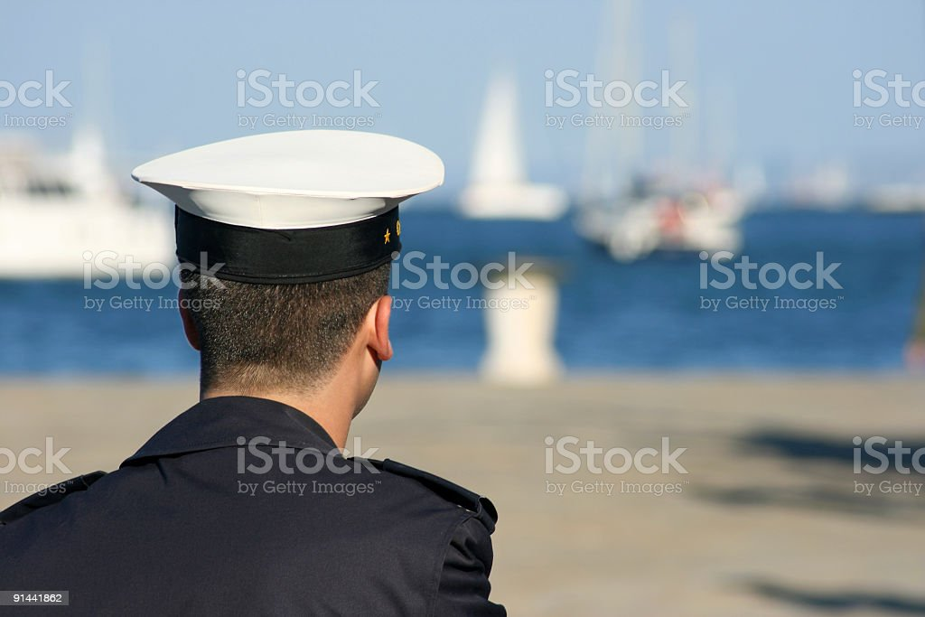 Young sailor in the harbor stock photo