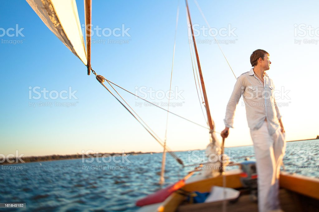 Young sailor looking into the distance stock photo