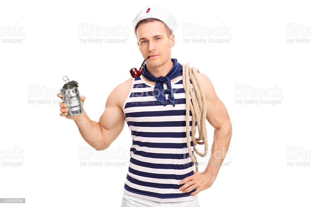 Young sailor smoking tobacco and holding an empty can stock photo