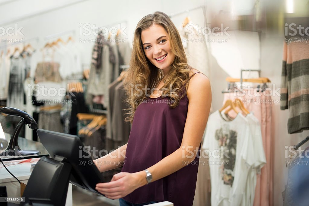 young sales assistant smiling to camera stock photo
