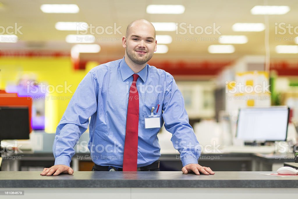 Young Salesman in Retail Store stock photo