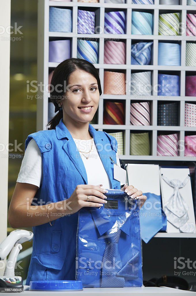 Young salesperson girl at clothes shop royalty-free stock photo