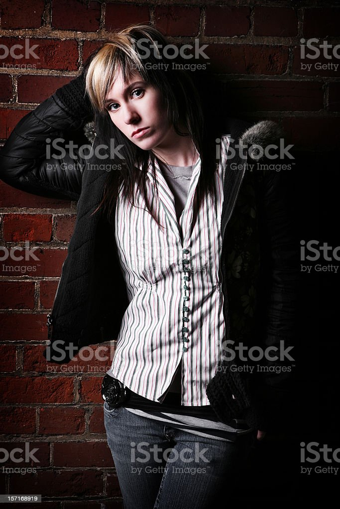 Young Scene Girl Against Brick Wall. royalty-free stock photo