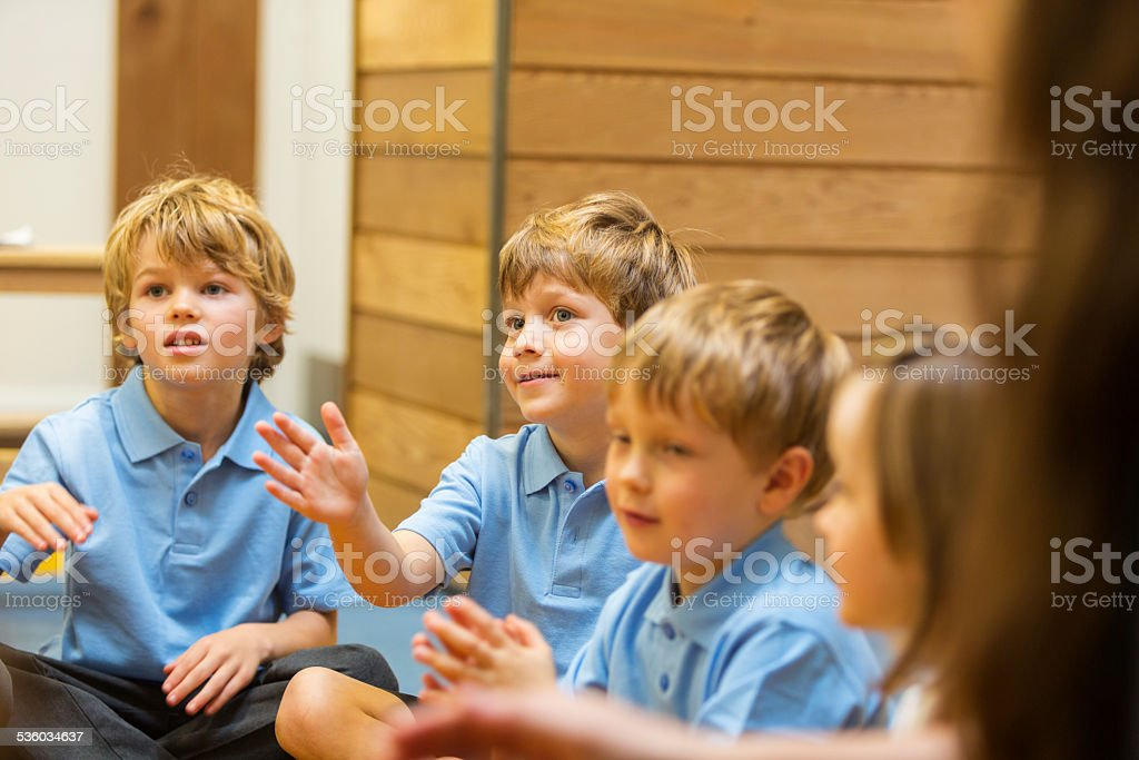 Young School Boys Interacting in the Classroom stock photo