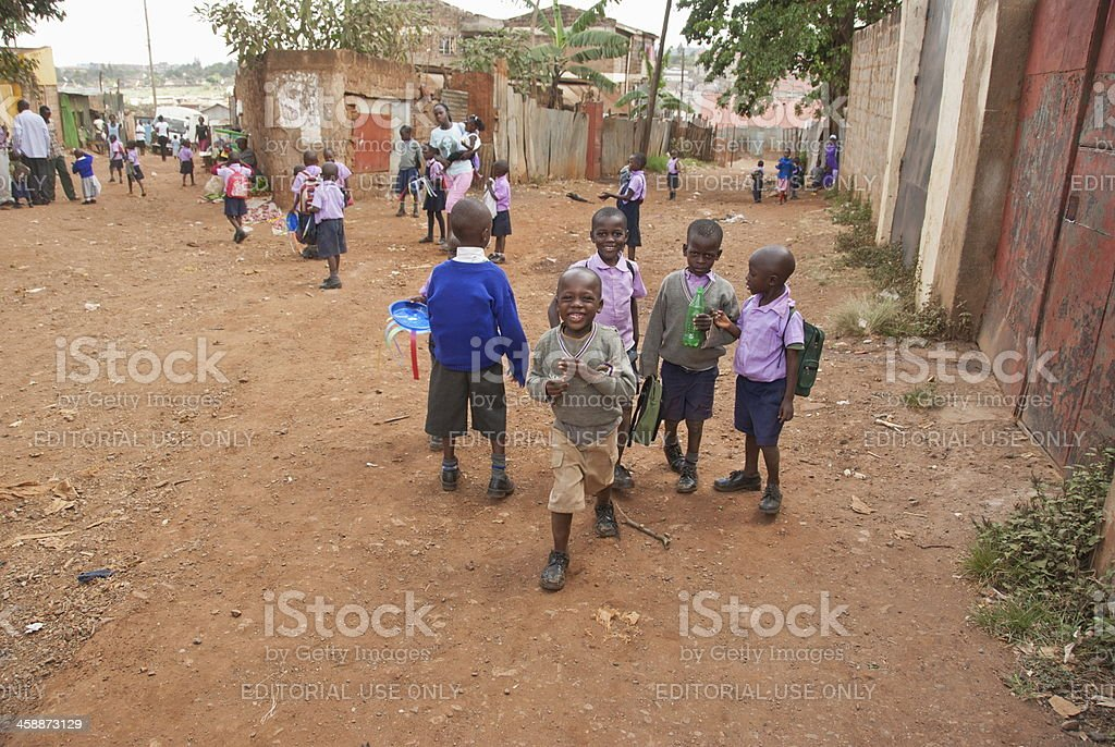 Young school boys on a street of Kibera, Nairobi, Kenya. stock photo