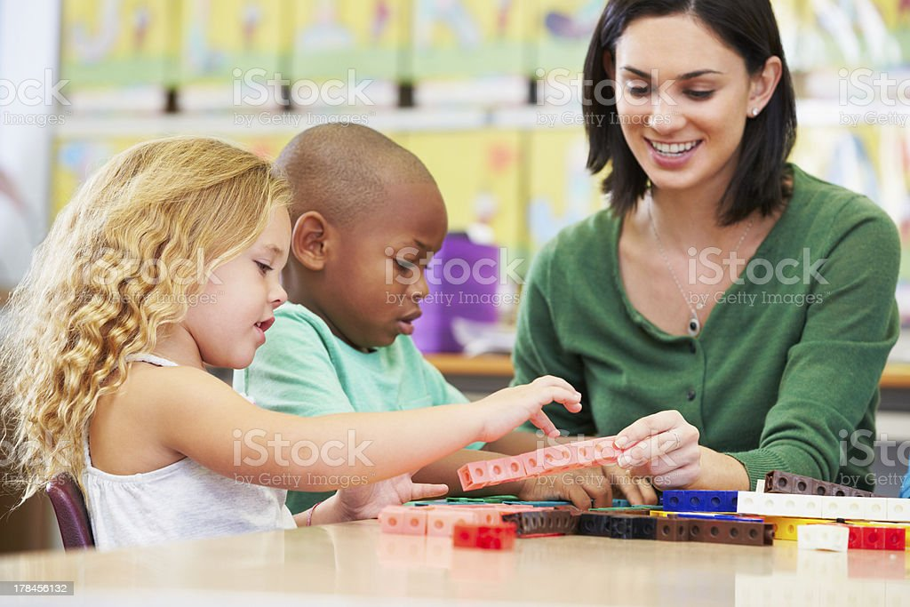 Young school children counting in a class room stock photo