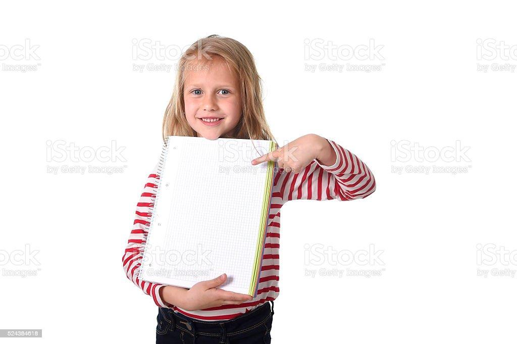 young schoolgirl holding big notebook school supply stock photo
