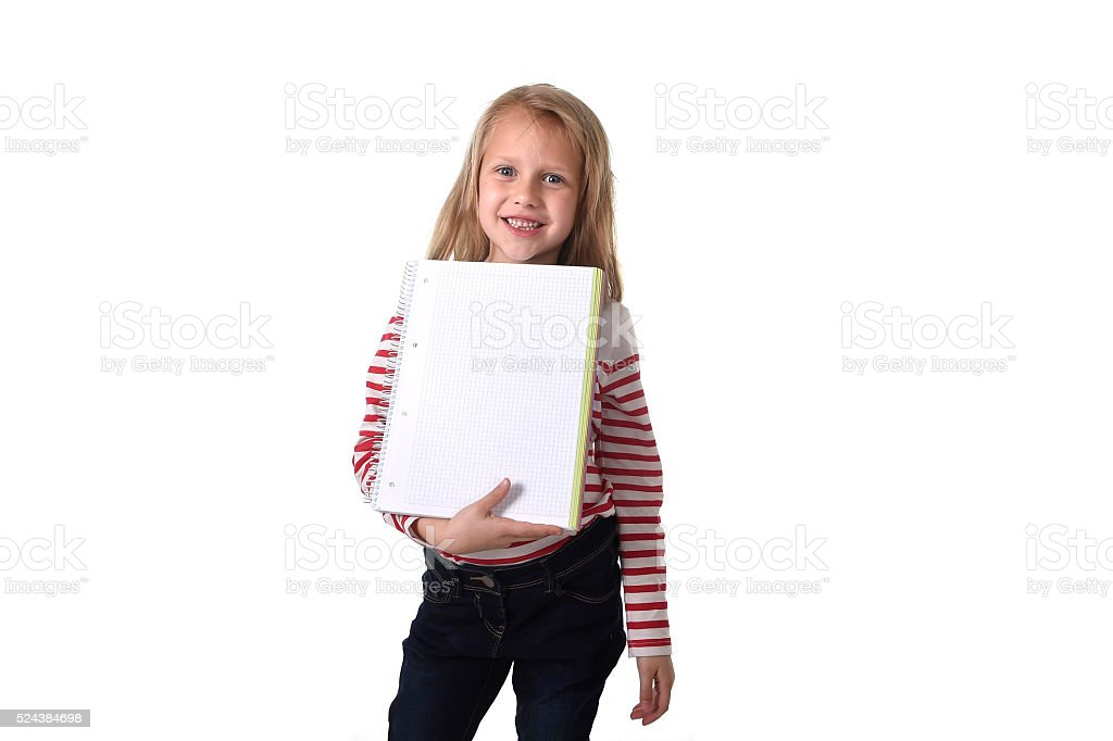 young schoolgirl holding big notebook school supply stock photo