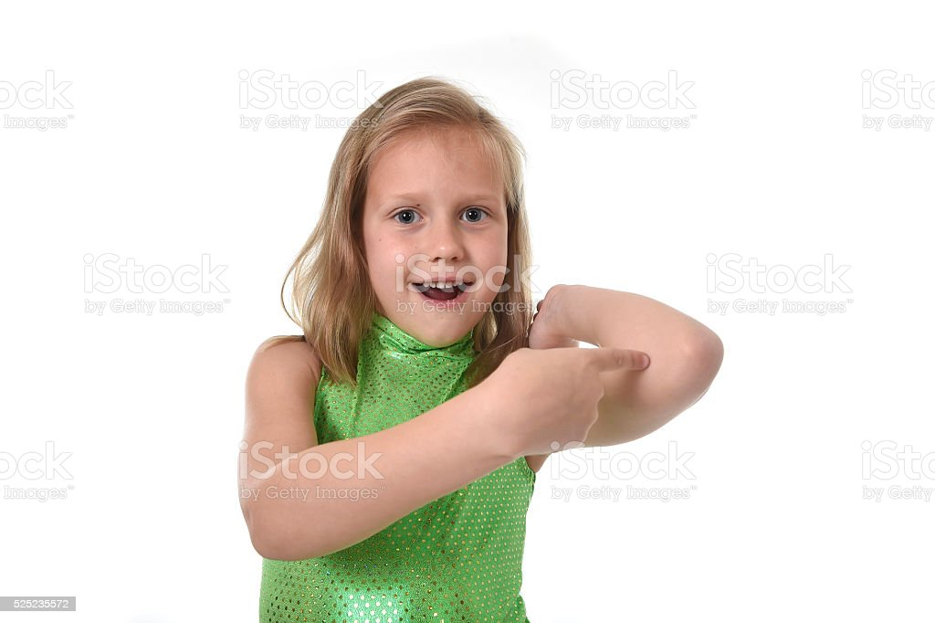 young schoolgirl pointing elbow in body parts learning English words stock photo
