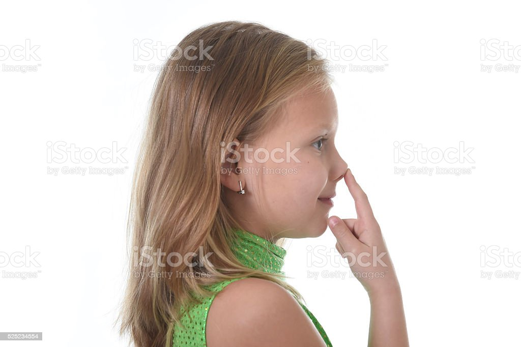 young schoolgirl pointing nose in body parts learning school chart stock photo