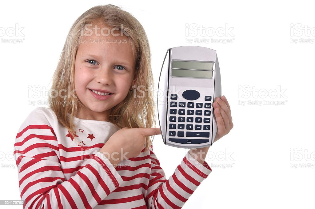 young schoolgirl smiling holding big calculator in school maths concept stock photo
