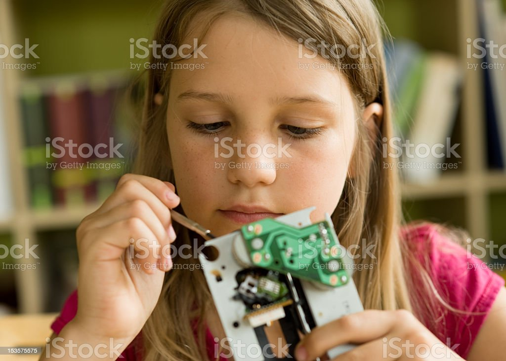 A young scientist looking at a circuit board royalty-free stock photo