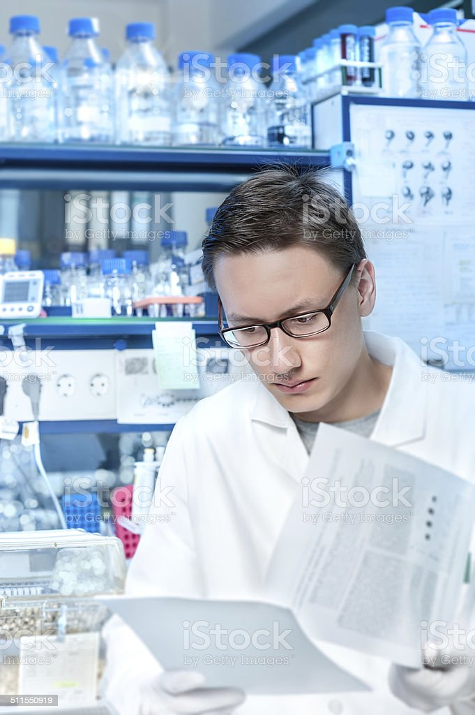 Young scientist or tech works in modern lab stock photo