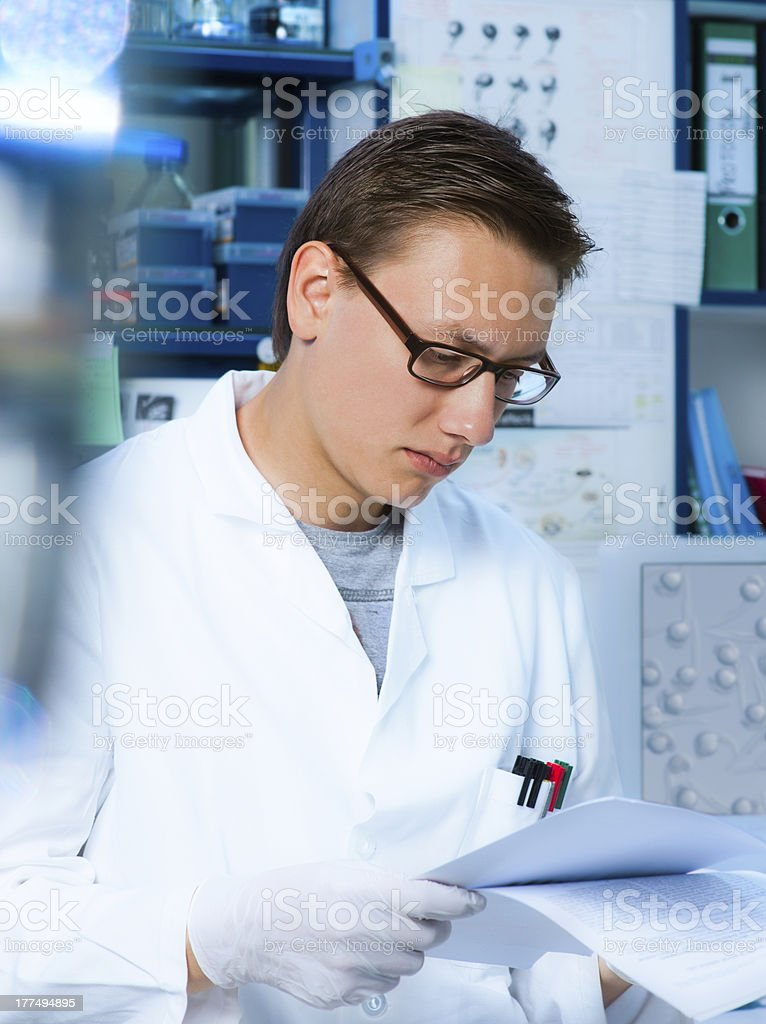 Young scientist reading royalty-free stock photo