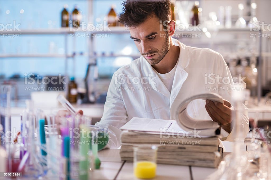 Young scientist reading scientific data in a laboratory. stock photo