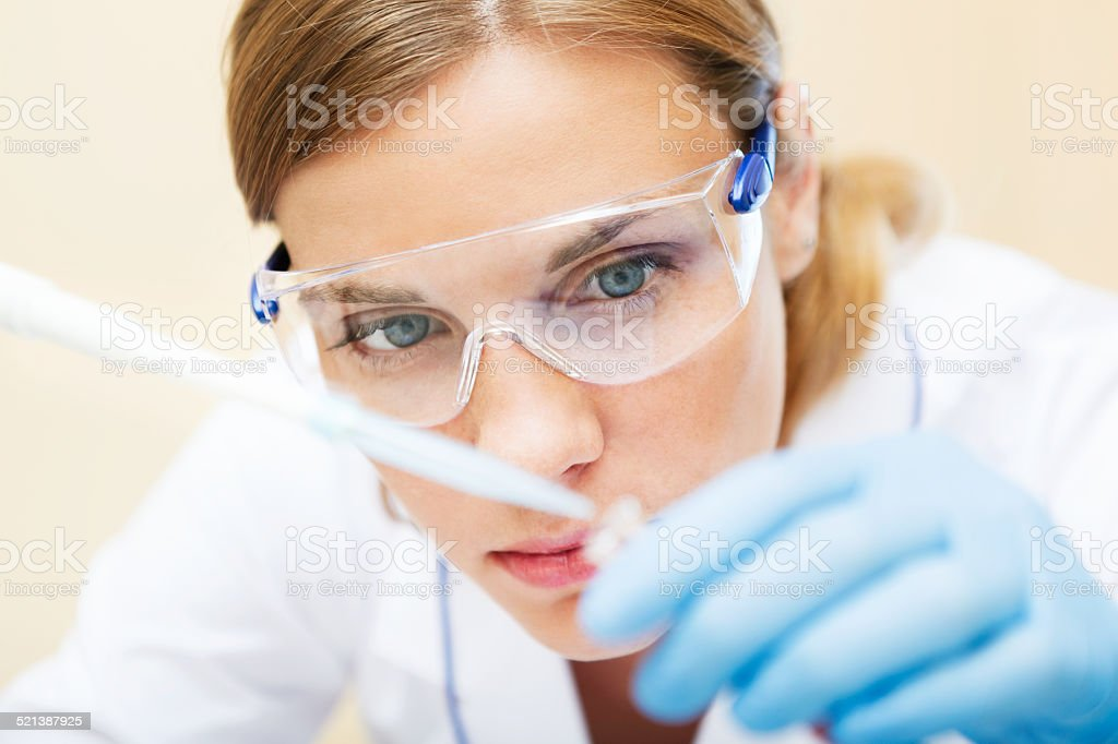Young scientist working with samples in lab. stock photo