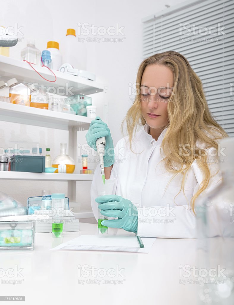 Young scientist works in the lab stock photo