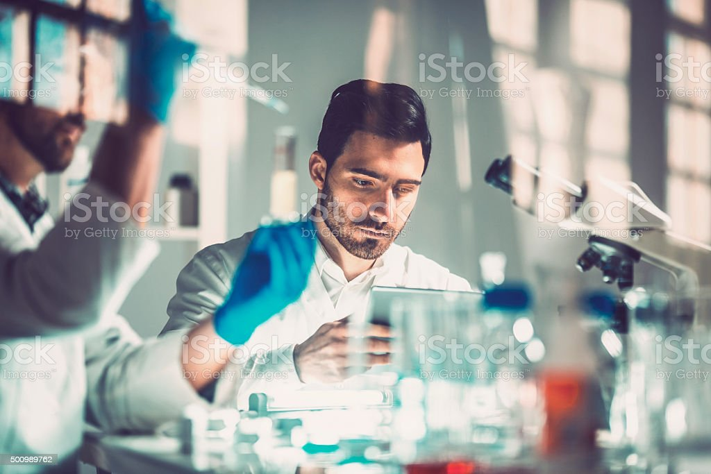 Young scientists in laboratory, research, technology.