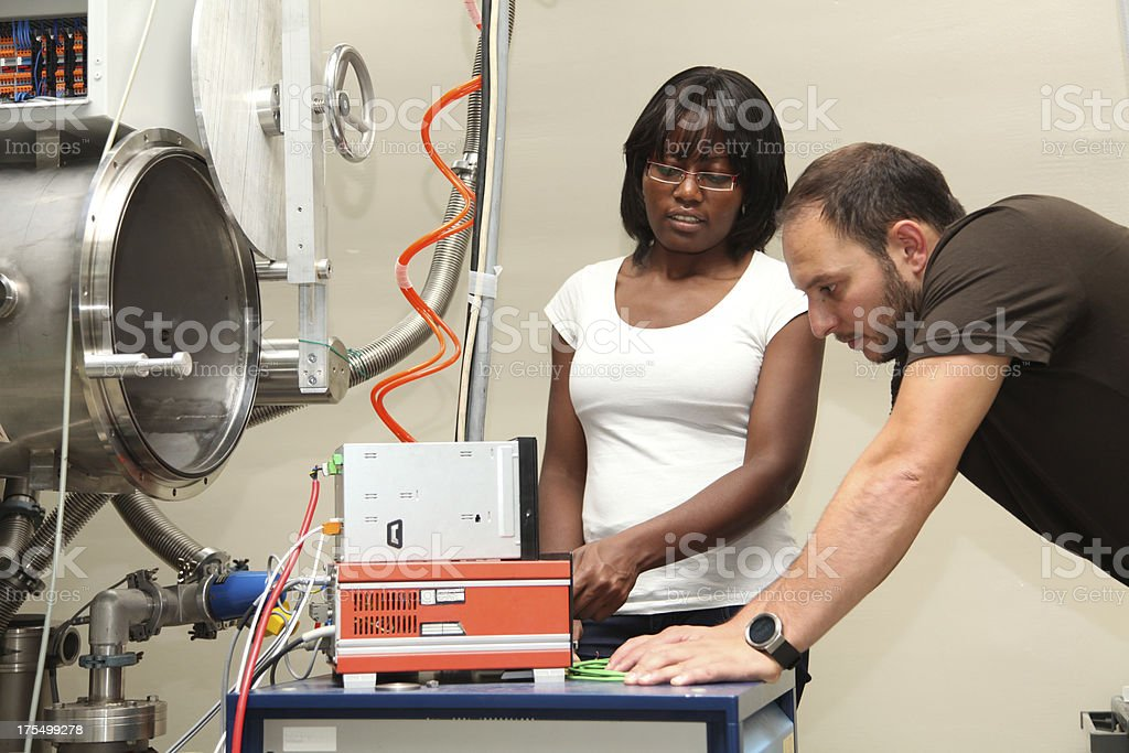 Young scientists in research laboratory stock photo