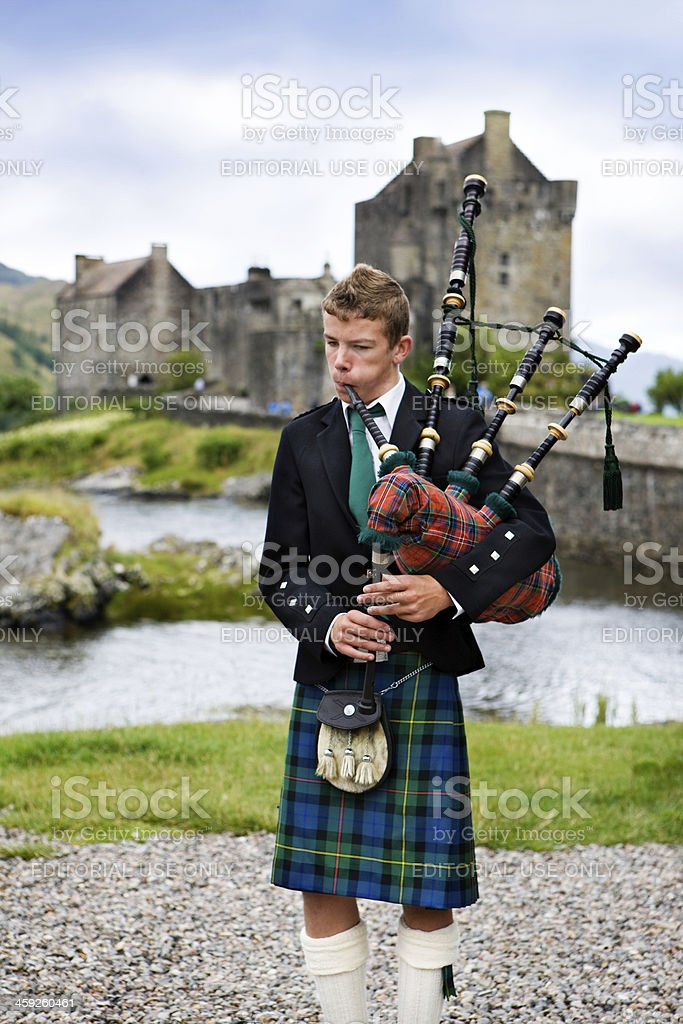 young scottish bagpiper stock photo