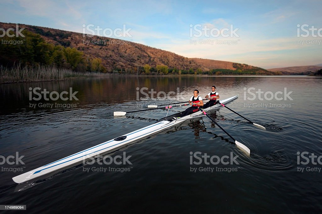 Young scull rower team with wide angle shot stock photo